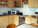 Open style fully equipped kitchen with access to rear terrace