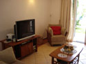 Livingroom with TV/DVD/CD player and direct access to front terrace, pool and garden