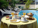 Breakfast is served by the pool or in the restaurant, seven days a week.