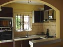 Open style fully equipped kitchen.
